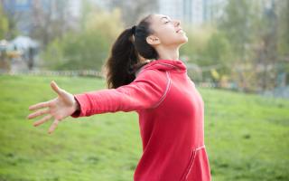 sporty-woman-feeling-alive