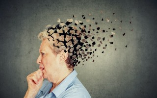 Memory loss due to dementia. Senior woman losing parts of head feeling confused as symbol of decreased mind function.